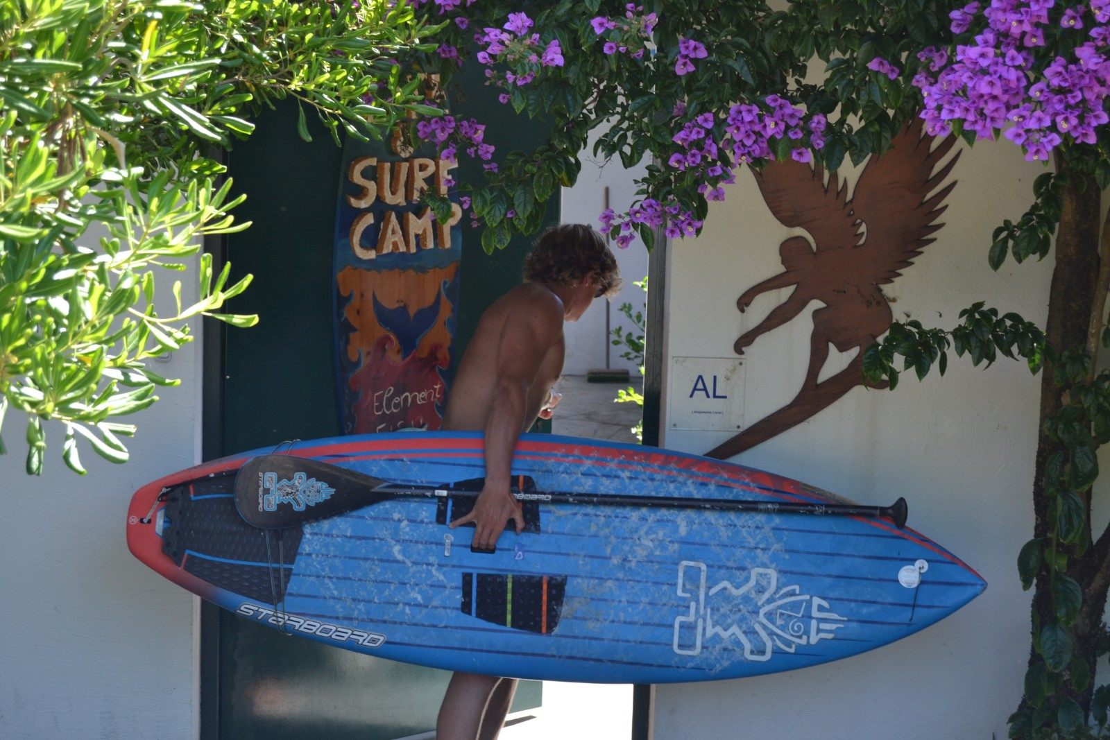 Standup paddle surfer at ElementFish surfcamp, Portugal