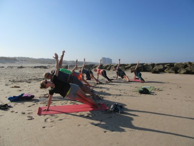 Yoga on the beach at ElementFish kitecamp in Portugal